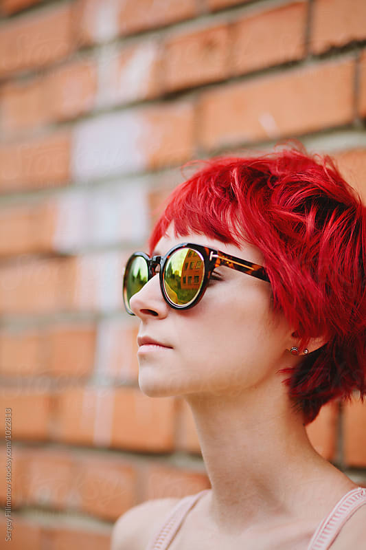 Bright red-haired girl in sunglasses by Sergey Filimonov for Stocksy United