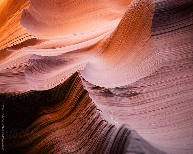 Waves of colorful sandstone in Arizona slot canyon by Jeremy Pawlowski for Stocksy United
