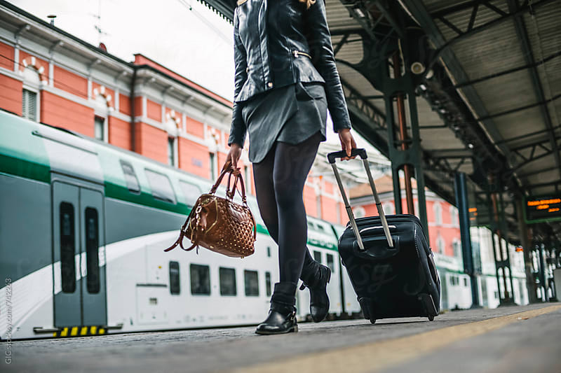 Businesswoman at the train station by Simone Becchetti for Stocksy United