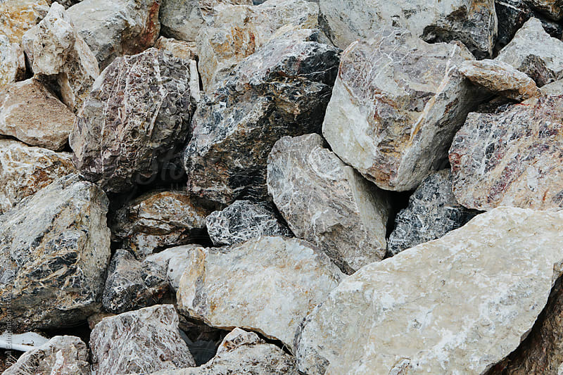 Pile of large boulders, close up by Paul Edmondson for Stocksy United