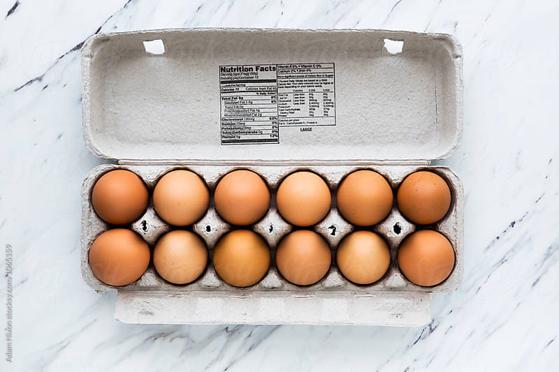 One dozen pasture raised brown eggs with nutrition information by Adam Nixon for Stocksy United