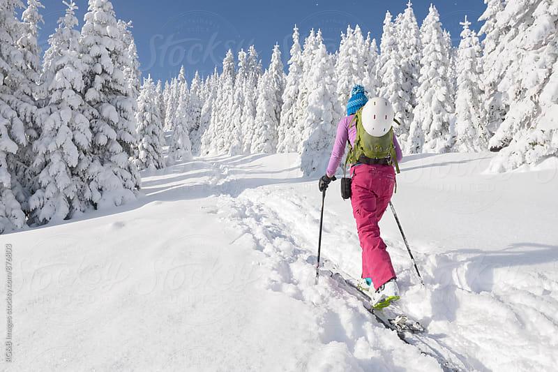 Female ski tourer going uphill by RG&B Images for Stocksy United