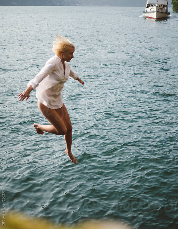 Woman diving in the lake by GIC for Stocksy United