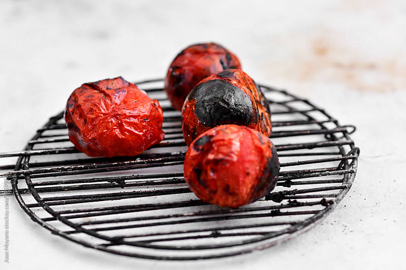 roasted tomatoes by juan moyano for Stocksy United