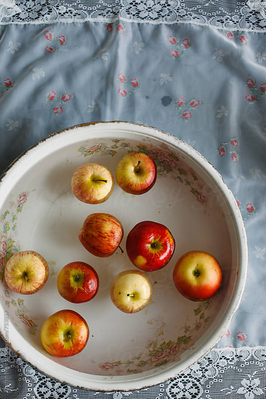 Apple bobbing. by Darren Muir for Stocksy United