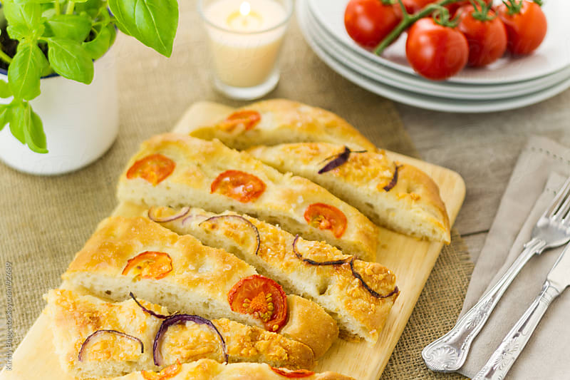 Sliced focaccia horizontal by Kirsty Begg for Stocksy United