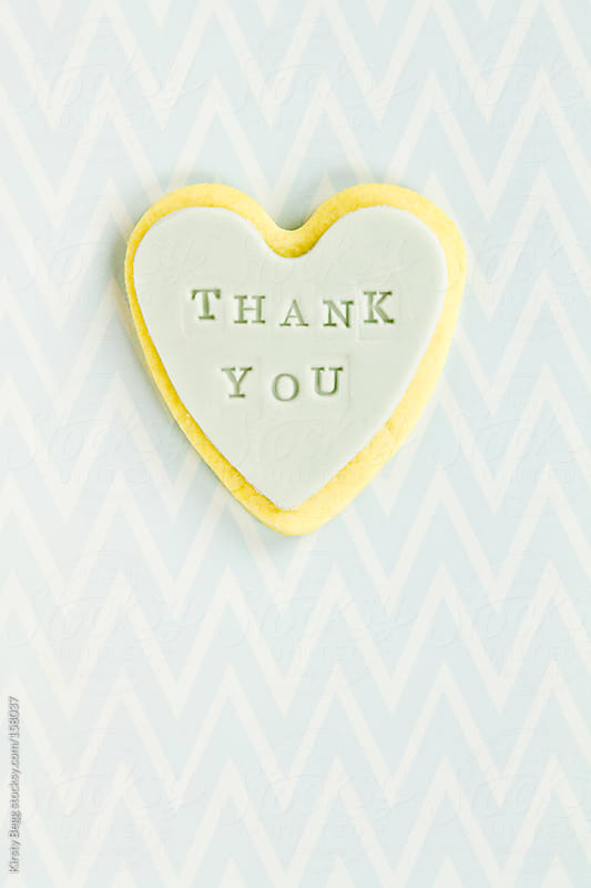 Thank you cookie on chevron background by Kirsty Begg for Stocksy United