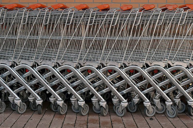 Row of shopping carts by Marcel for Stocksy United