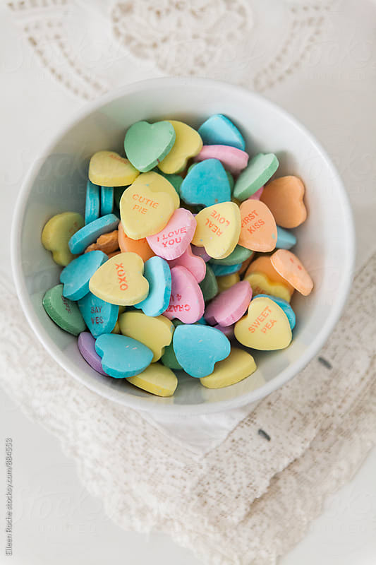 sweethearts valentines candy  by Eileen Roche for Stocksy United