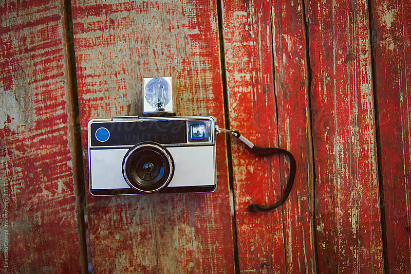 old vintage camera over table by Leandro Crespi for Stocksy United