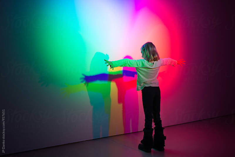 Girl Playing Making Shadows With Colorful Spectrum Multi Color Theatre Lights by JP Danko for Stocksy United