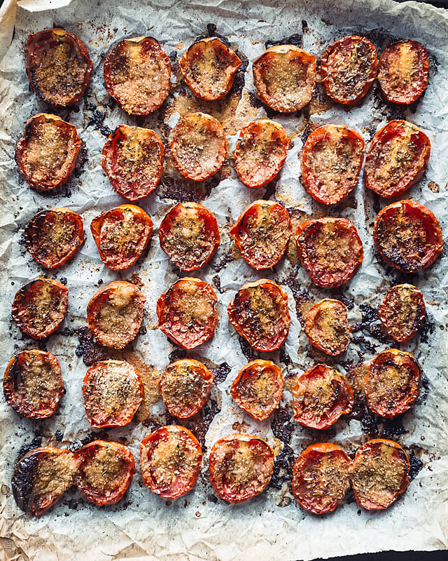 tomatoes just grilled by Juri Pozzi for Stocksy United