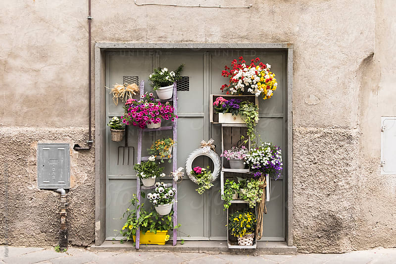 Door decorated with flowers by Marilar Irastorza for Stocksy United