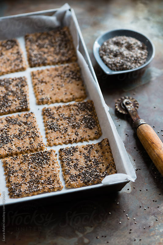preparing wholemeal crackers with chia seeds by Laura Adani for Stocksy United