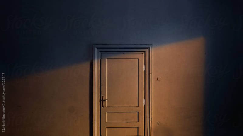 Sunray on closed door by Marko Milovanović for Stocksy United