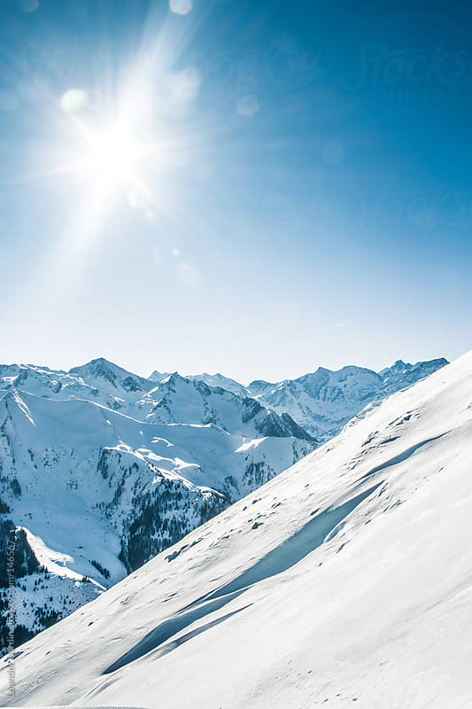 Snowcovered Mountain scenery in the austrian alps by Leander Nardin for Stocksy United