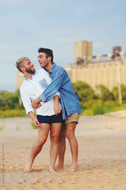 Young gay couple by Chelsea Victoria for Stocksy United