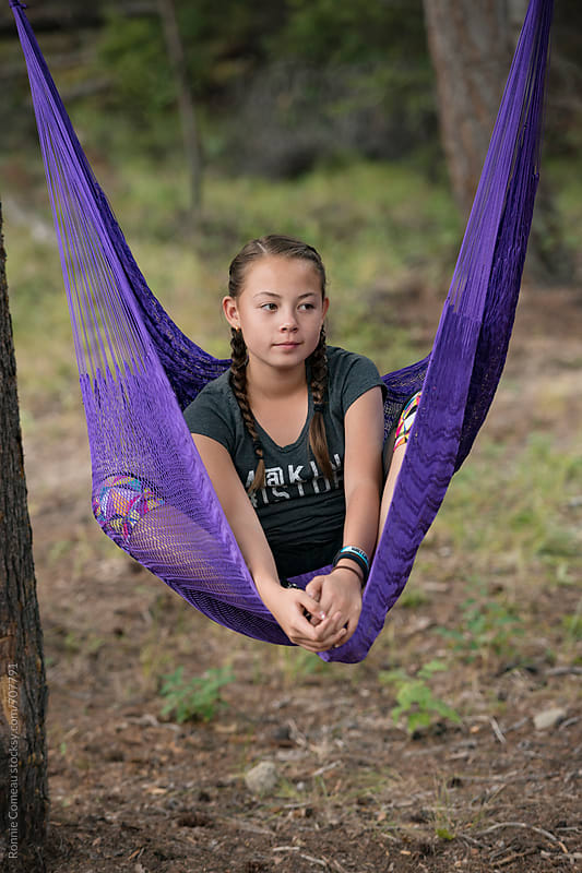 Preteen Girl In Hammock Chair by Ronnie Comeau for Stocksy United