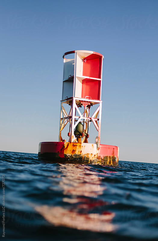 Channel Marker in Ocean Cape Cod, Massachusetts by Raymond Forbes LLC for Stocksy United