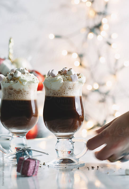 Hot chocolate: Hot chocolate drinks with cream and marshmallow. by Darren Muir for Stocksy United