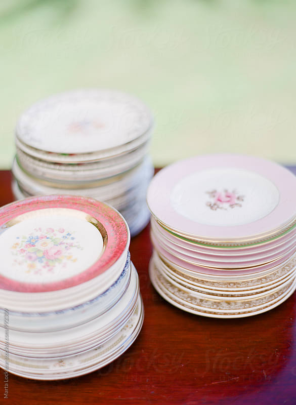 Antique floral plates, china by Marta Locklear for Stocksy United