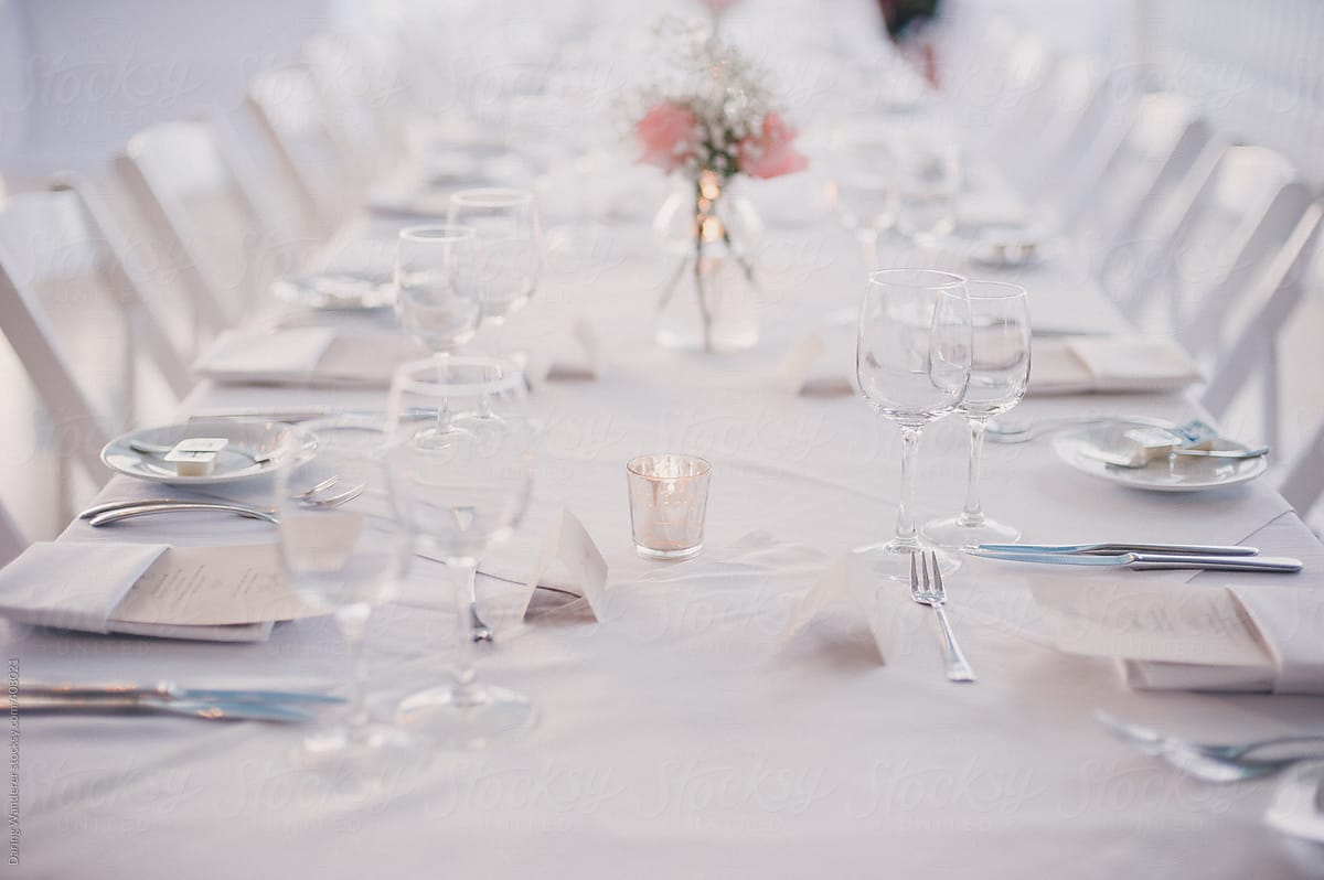 Simple white and pink wedding table setting by Jess Craven - Stocksy United