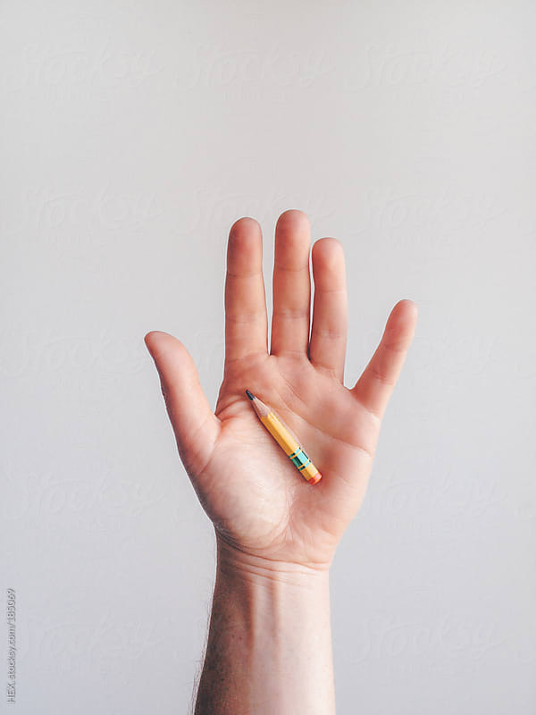 Hand holding One Small and Used Pencil by HEX. for Stocksy United