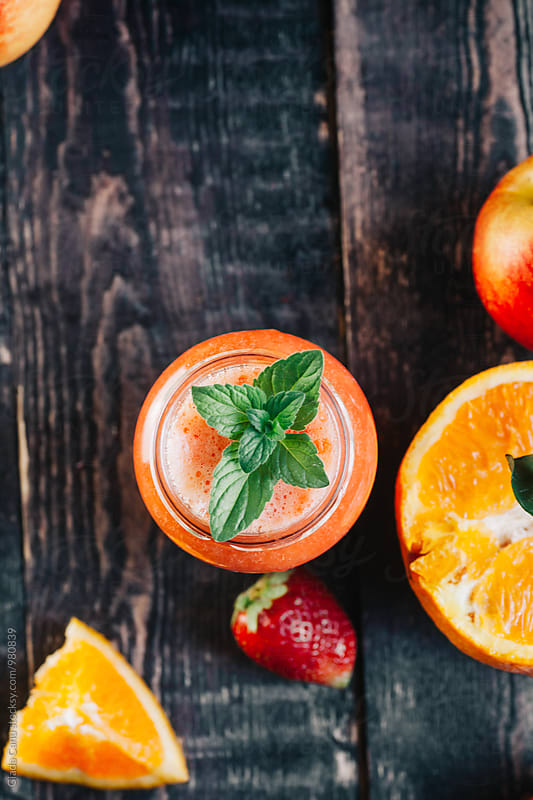 Peach, orange and strawberry smoothie by Giada Canu for Stocksy United