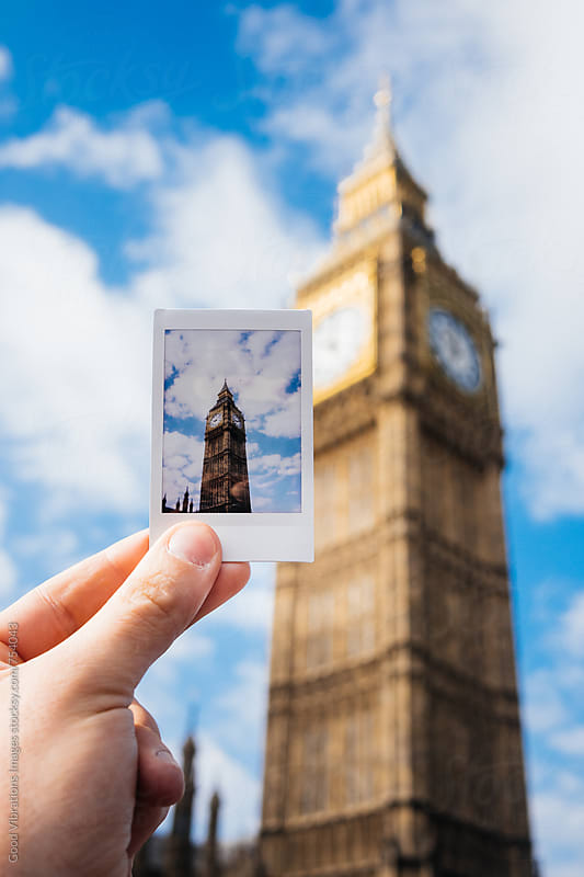 Hand holding an instant photo in front of the Big Ben, London, UK by Good Vibrations Images for Stocksy United