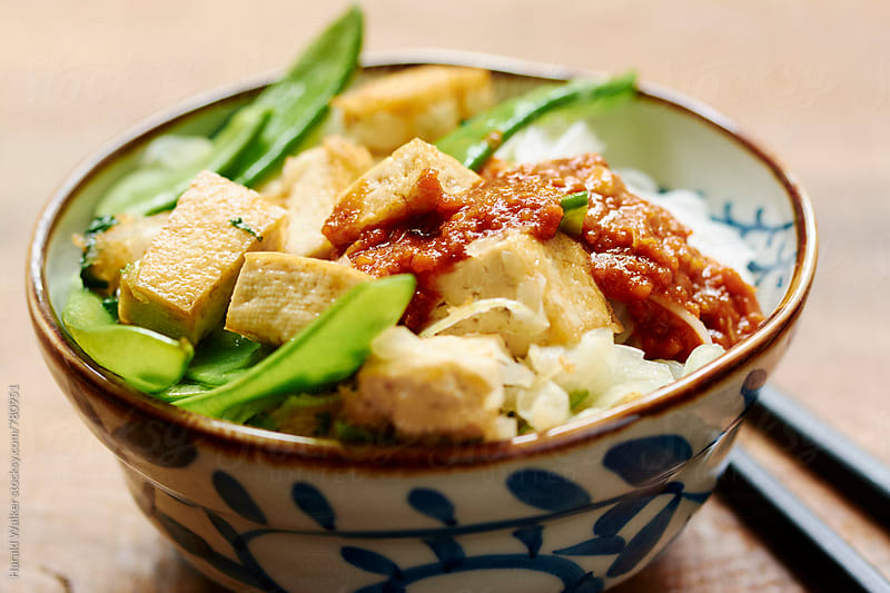Thai style tofu and snow peas by Harald Walker for Stocksy United