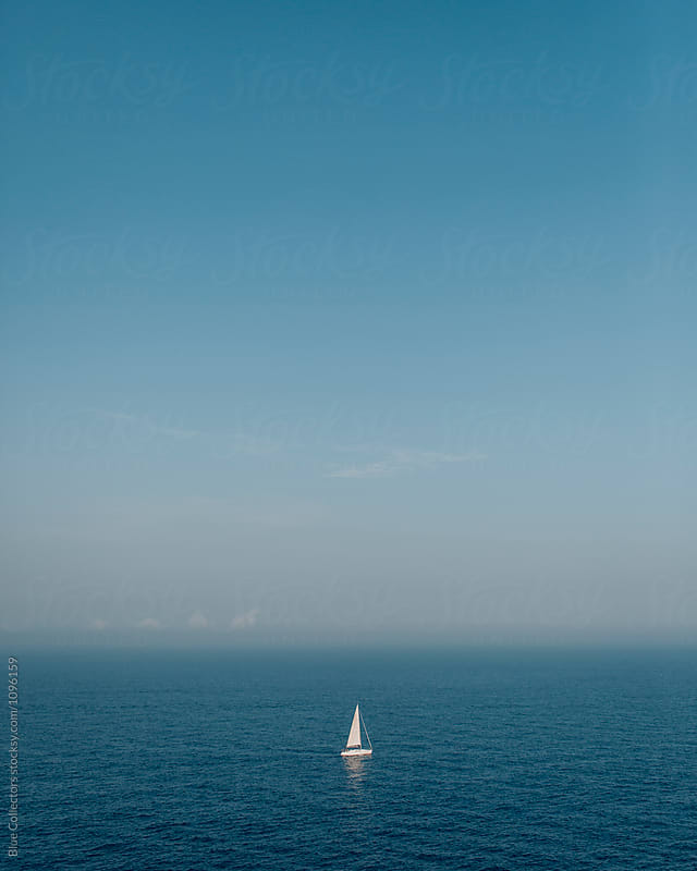 Elevated view of a sailing ship in the mediterranean sea by Jordi Rulló for Stocksy United