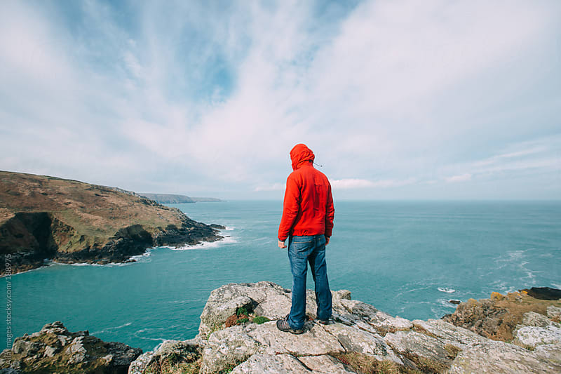 Man looking out to sea by Aila Images for Stocksy United