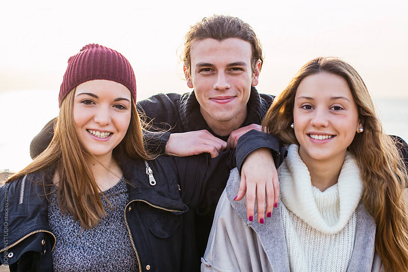 Portrait of teenage friends smiling. by BONNINSTUDIO for Stocksy United