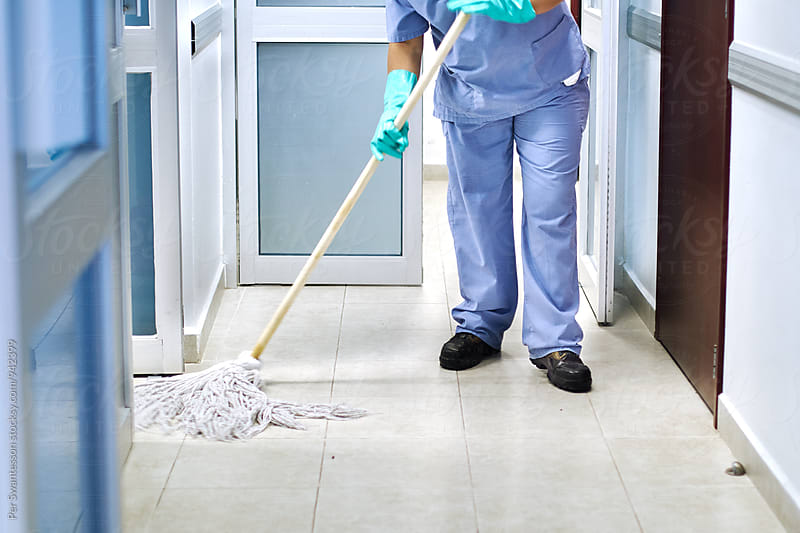 Cleaning staff in hospital by Per Swantesson for Stocksy United