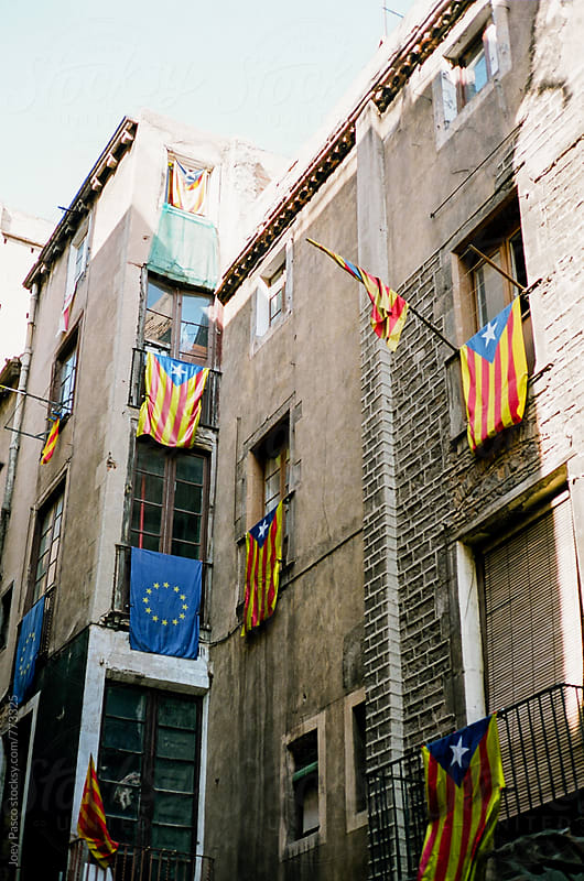 Flags Hanging from Balconies in Barcelona by Joey Pasco for Stocksy United