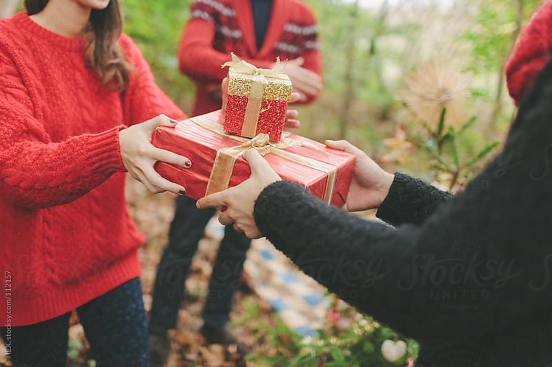 Friends Give Christmas Gifts by HEX. for Stocksy United