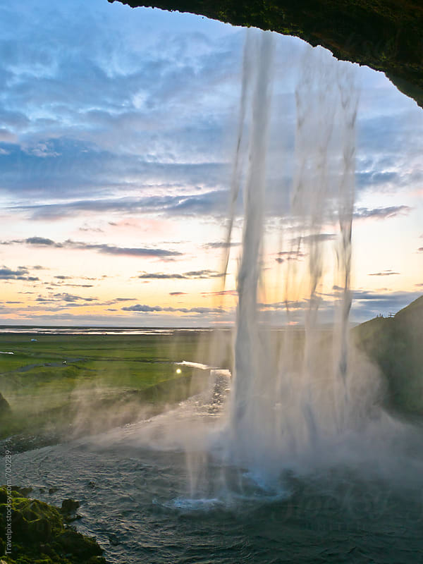 Seljalandsfoss waterfall at sunset. Iceland by Travelpix for Stocksy United