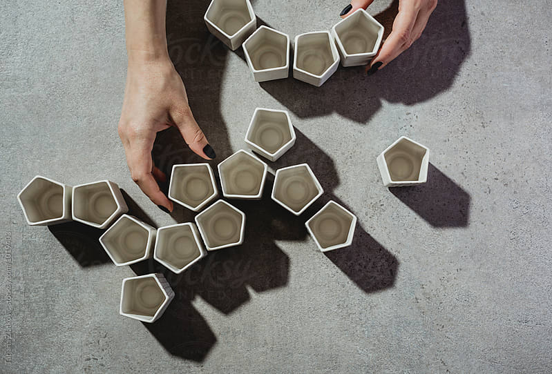 Hands making shape with ceramic cups by Tatjana Ristanic for Stocksy United