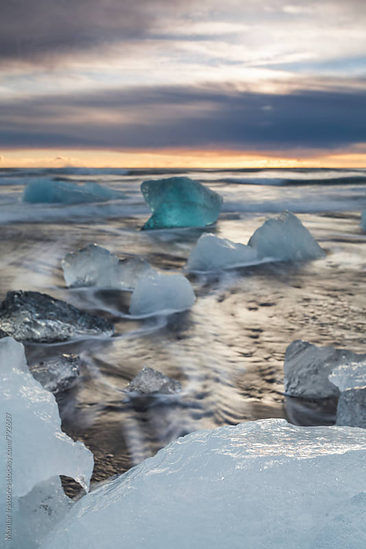 Icebergs on Jokulsarlon Beach at sunrise by Marilar Irastorza for Stocksy United