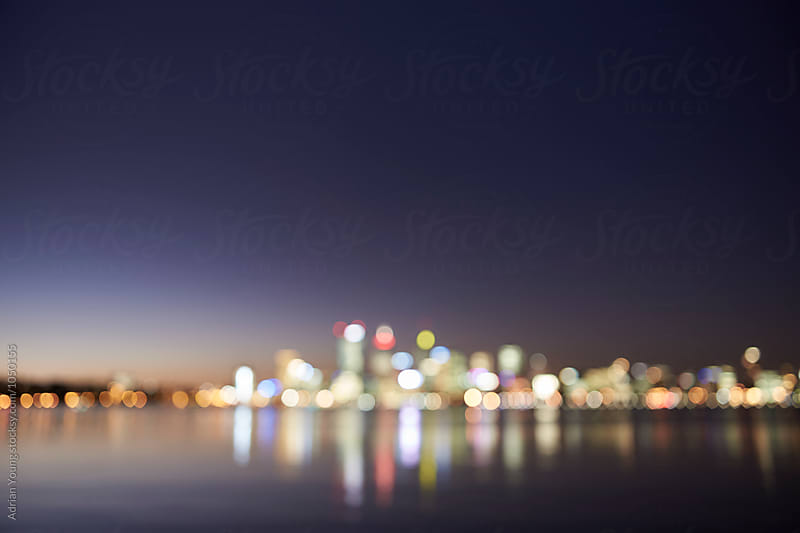 Out Of Focus Perth City Skyline At Dusk by Adrian Young for Stocksy United