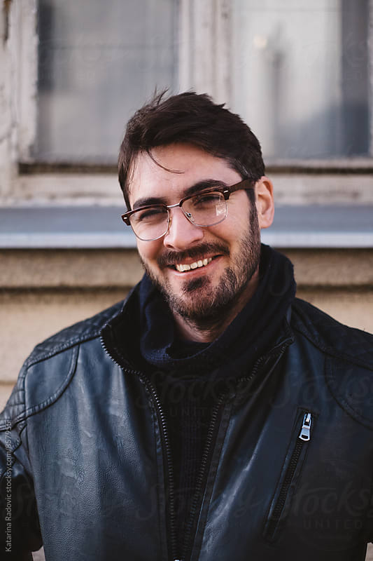 Portrait of a Handsome Man Smiling  by Katarina Radovic for Stocksy United