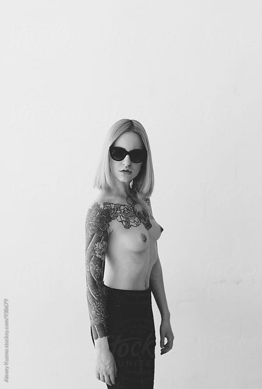 Topless young woman on the white background  by Alexey Kuzma for Stocksy United