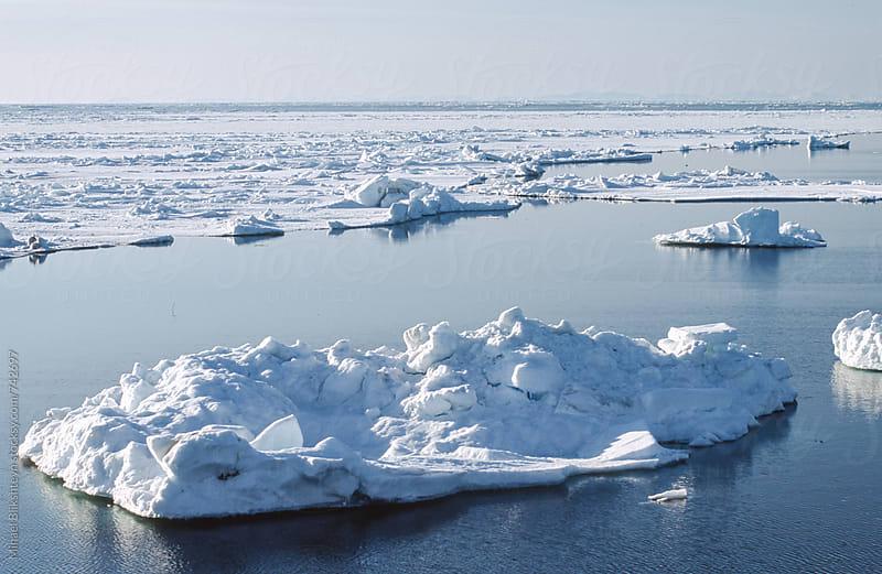 Ice floats in the middle of open ocean by Mihael Blikshteyn for Stocksy United
