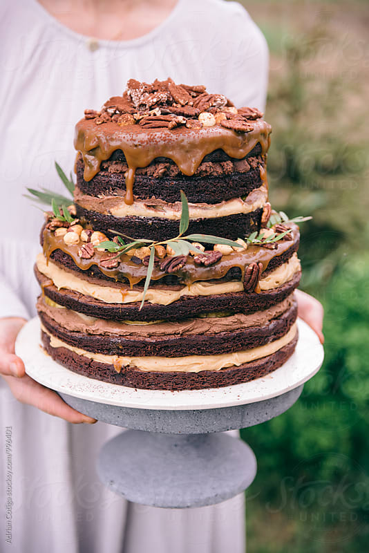 Homemade chocolate and caramel cake by Adrian Cotiga for Stocksy United