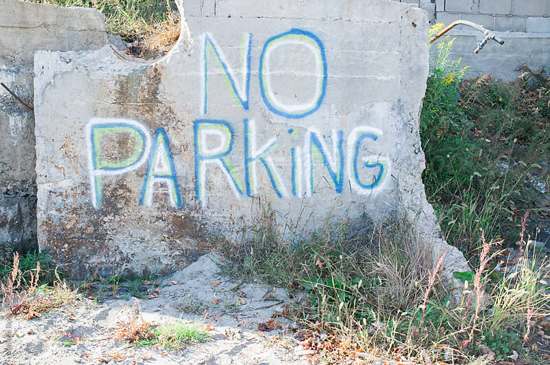 No Parking sign. by Melissa Ross for Stocksy United