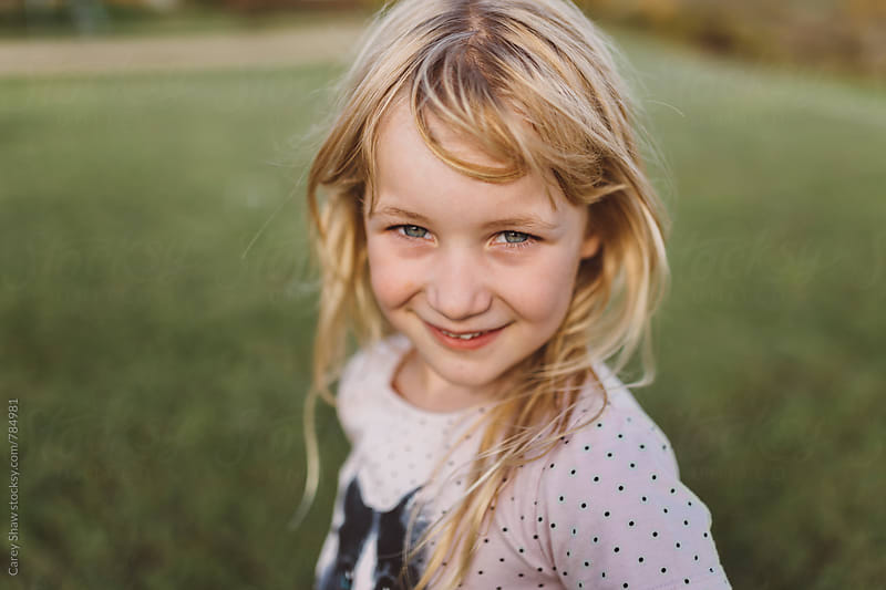 Portrait of smiling young girl by Carey Shaw for Stocksy United