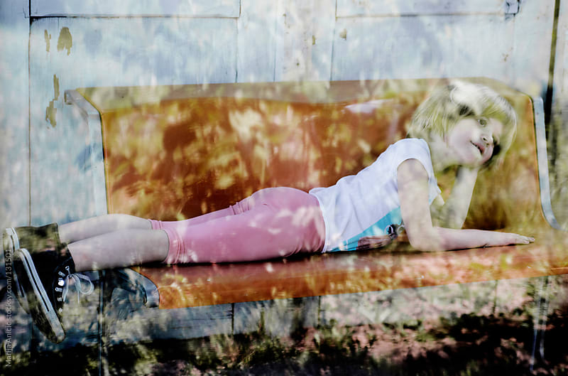 Little cute girl daydreaming on the bench by Marija Anicic for Stocksy United