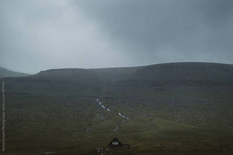 Solitary A-Frame House in the middle of the Mountains of the Faroe Islands by Rachel Gulotta Photography for Stocksy United