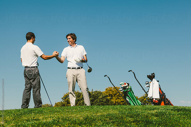 Two Golfers Shaking Hands by VICTOR TORRES for Stocksy United
