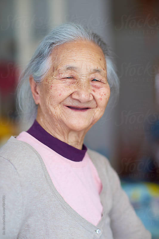 portrait of senior asian woman by Bo Bo for Stocksy United